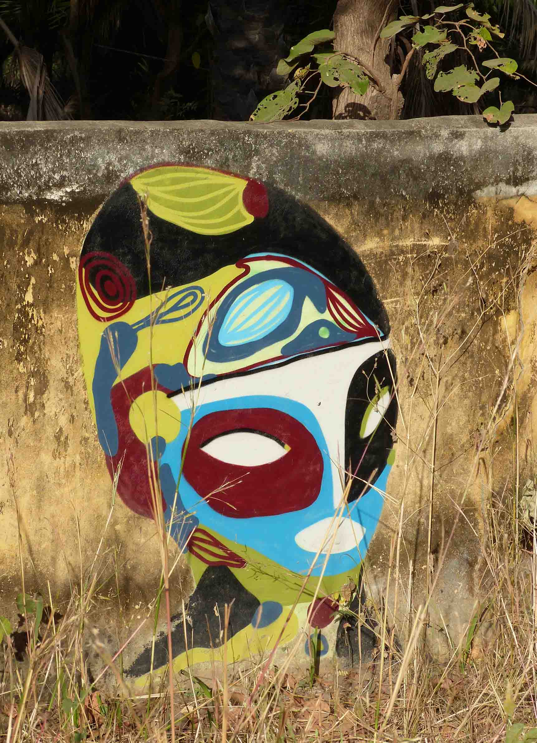 Colourful mural of a face