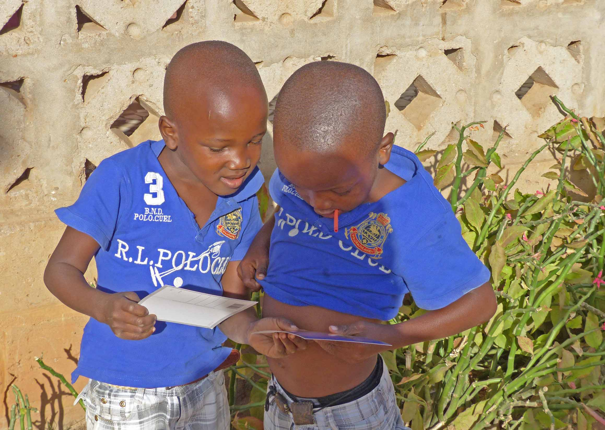 Two young boys in blue football tops