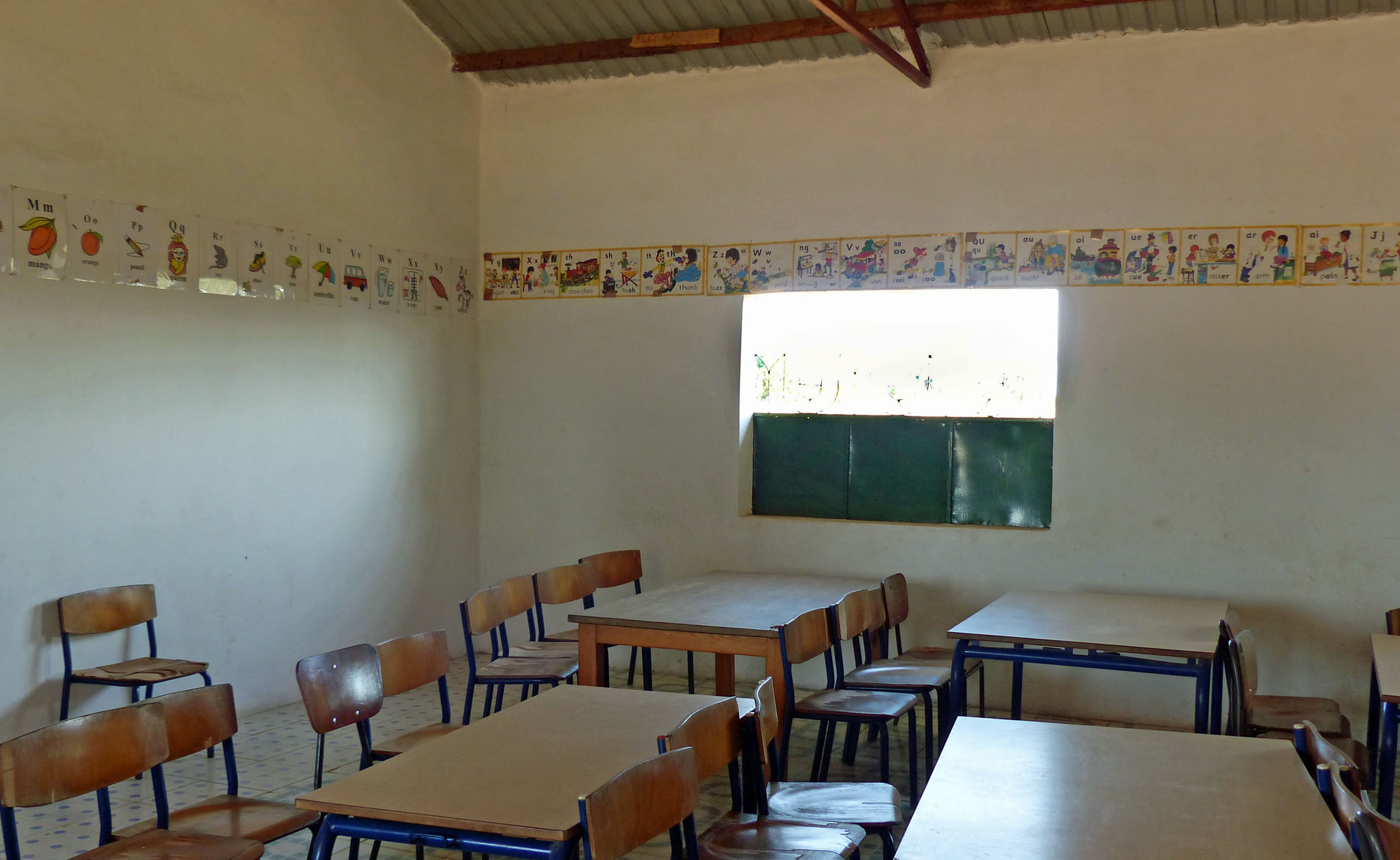 Classroom with wooden desks and chairs