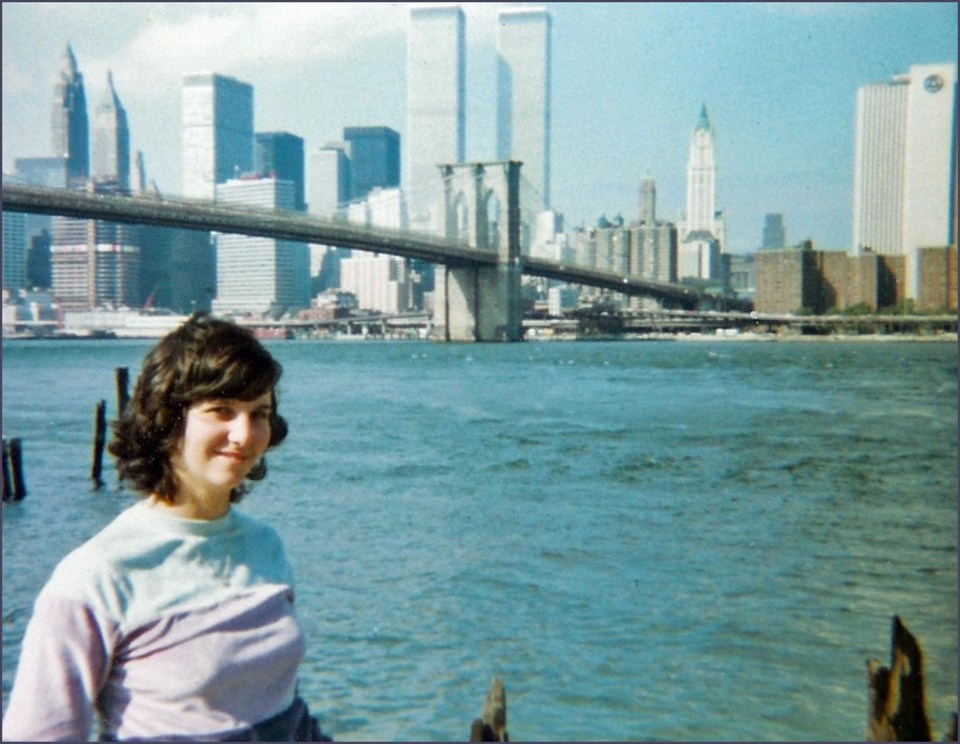 Young woman in front of New York skyline