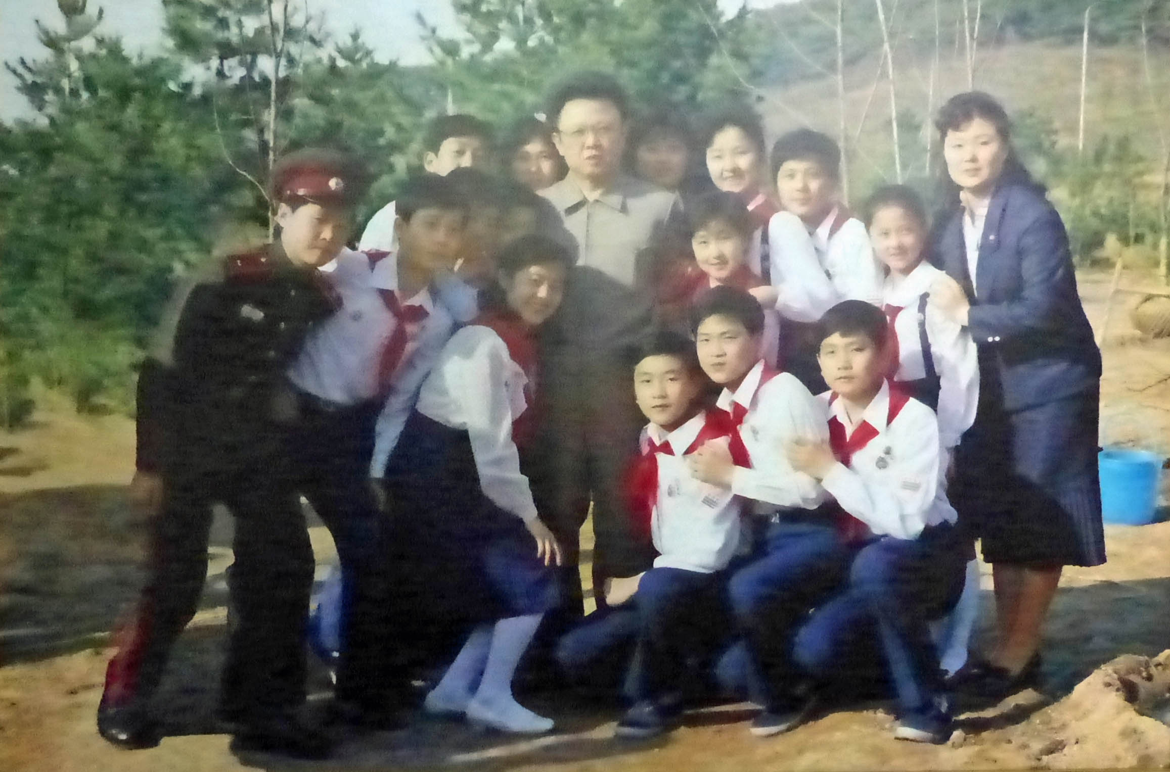 Photo of Kim Jong Il with school pupils