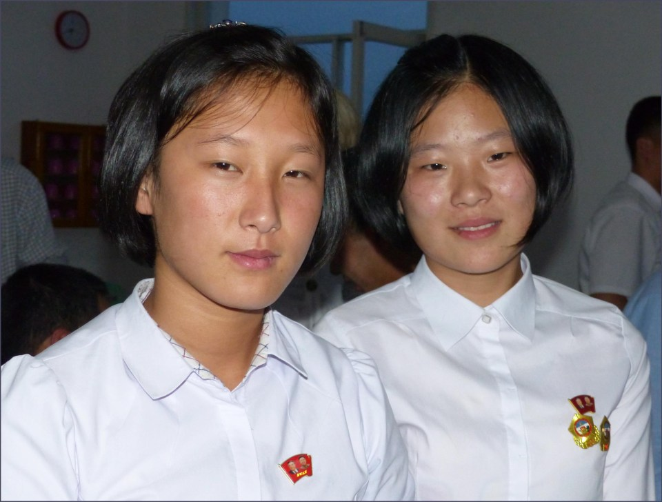 Two teenage girls in white shirts