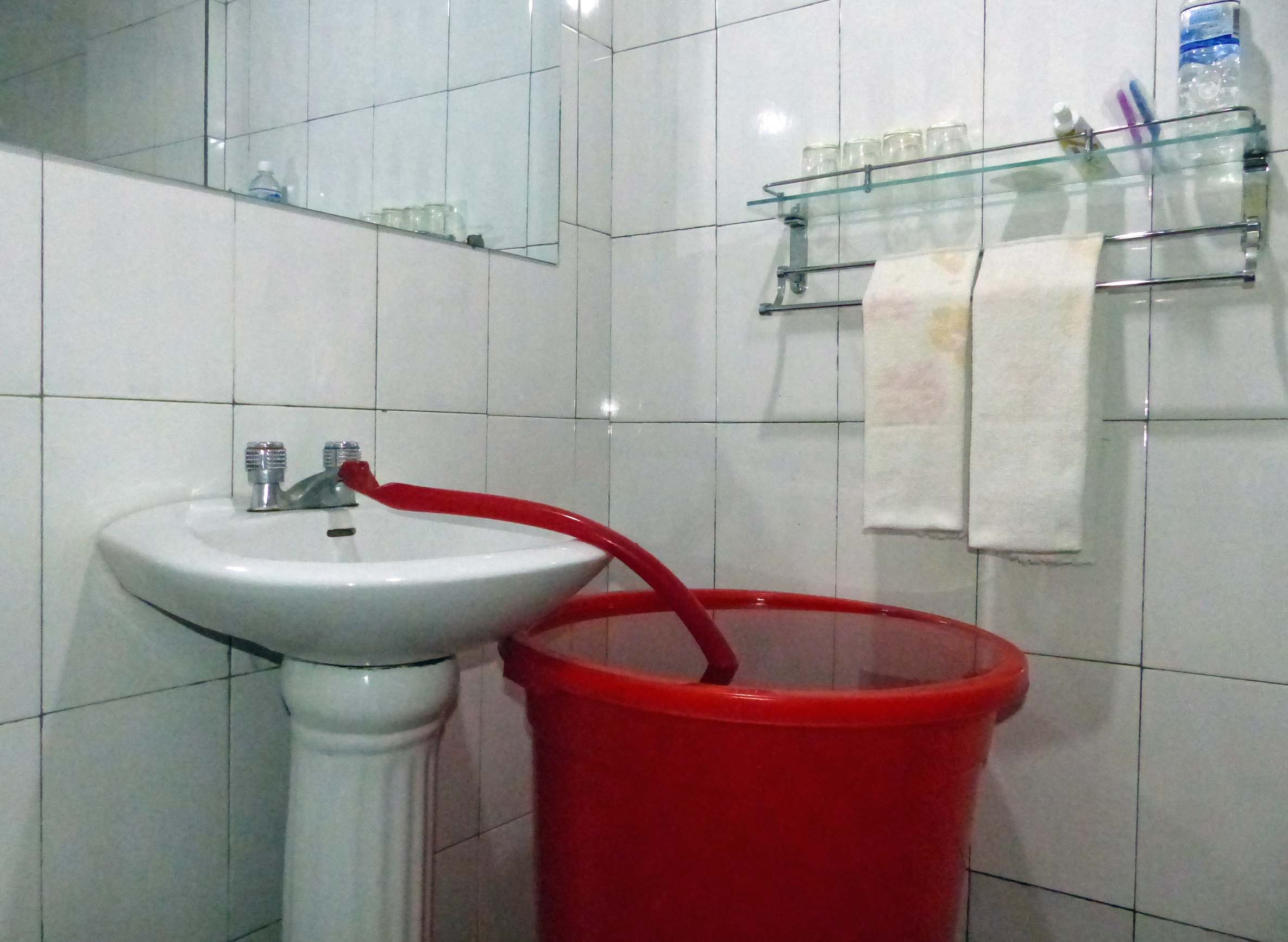 Big red tub with hose from washbasin tap