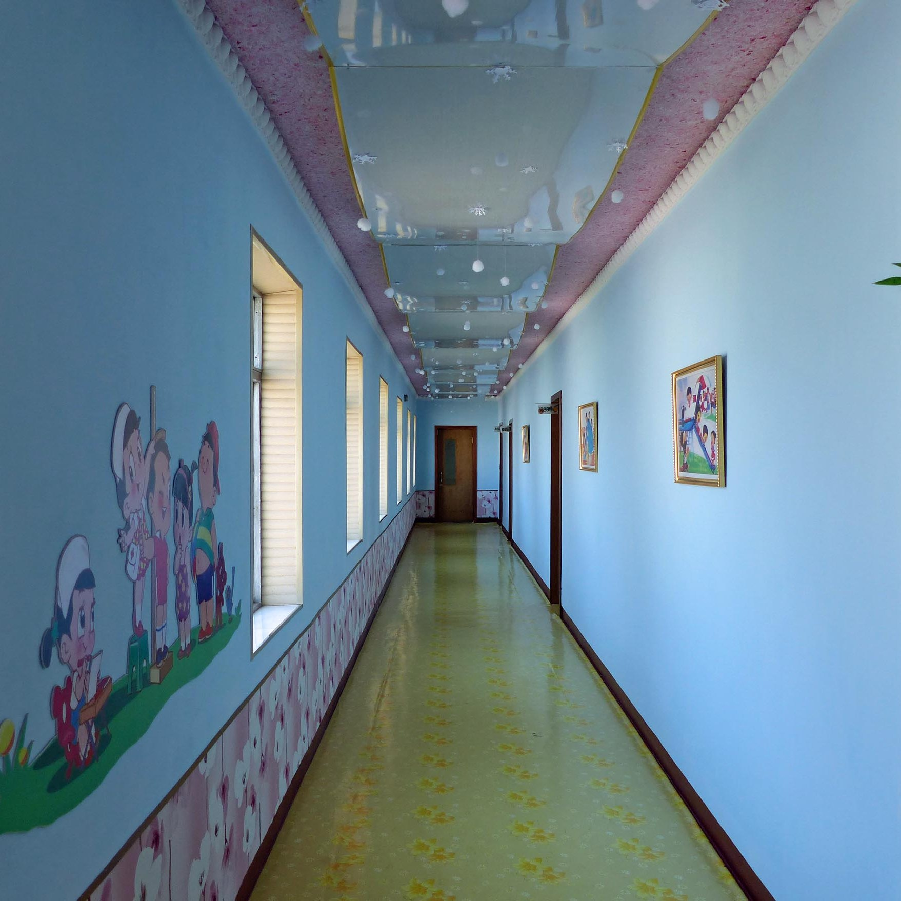 Corridor with pale blue walls and shiny floor