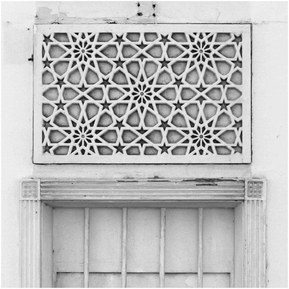 Black and white photo of wooden shutters