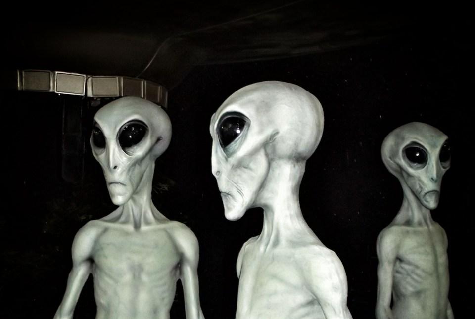 Three alien figures