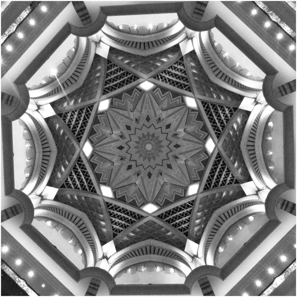 Black and white photo looking up into a dome