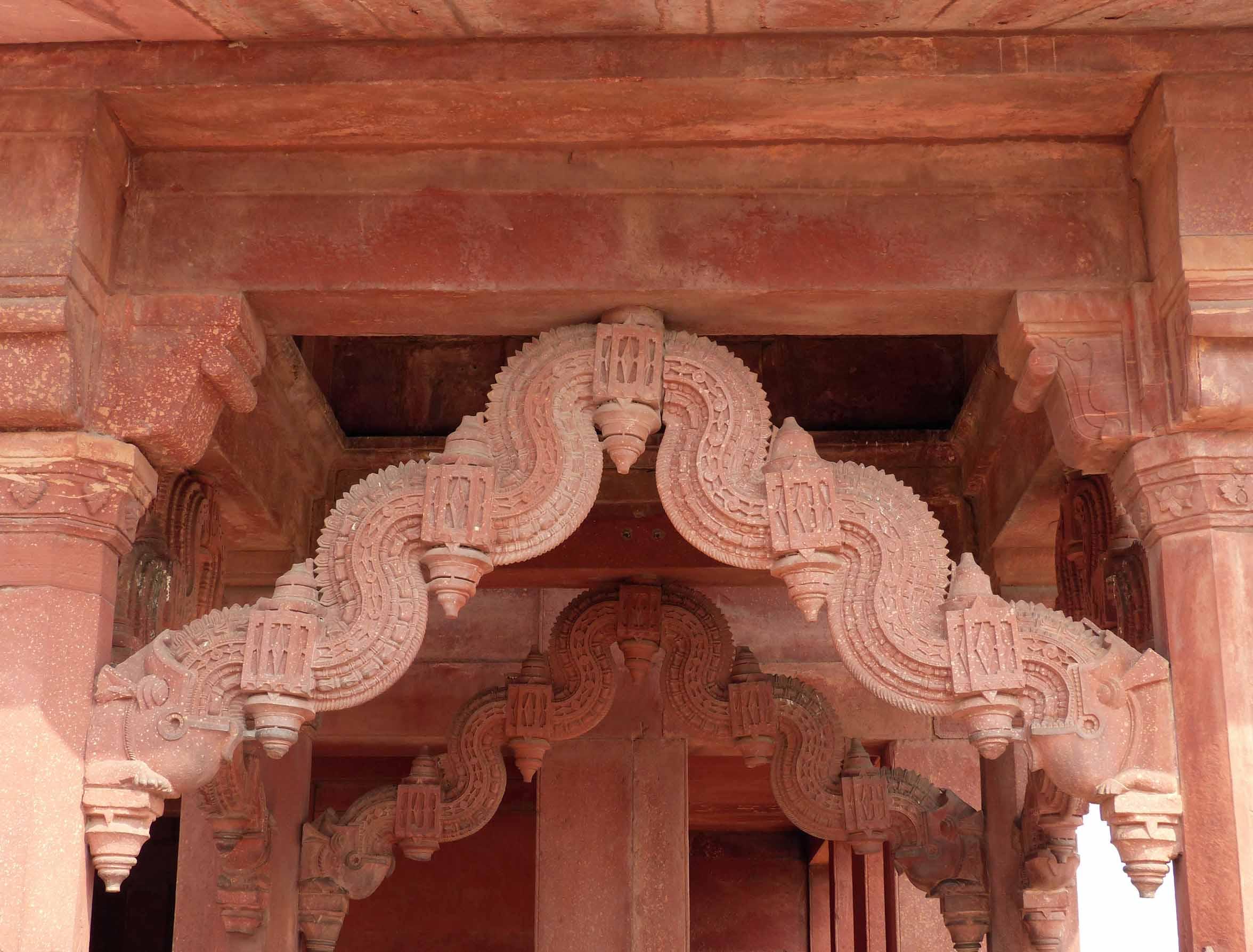 Carved detail of red sandstone building
