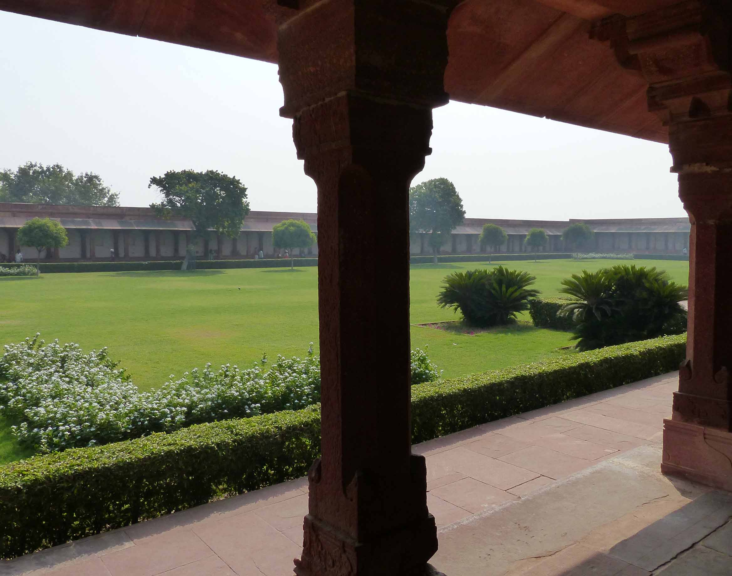 Large courtyard with lawn and surrounding arcade