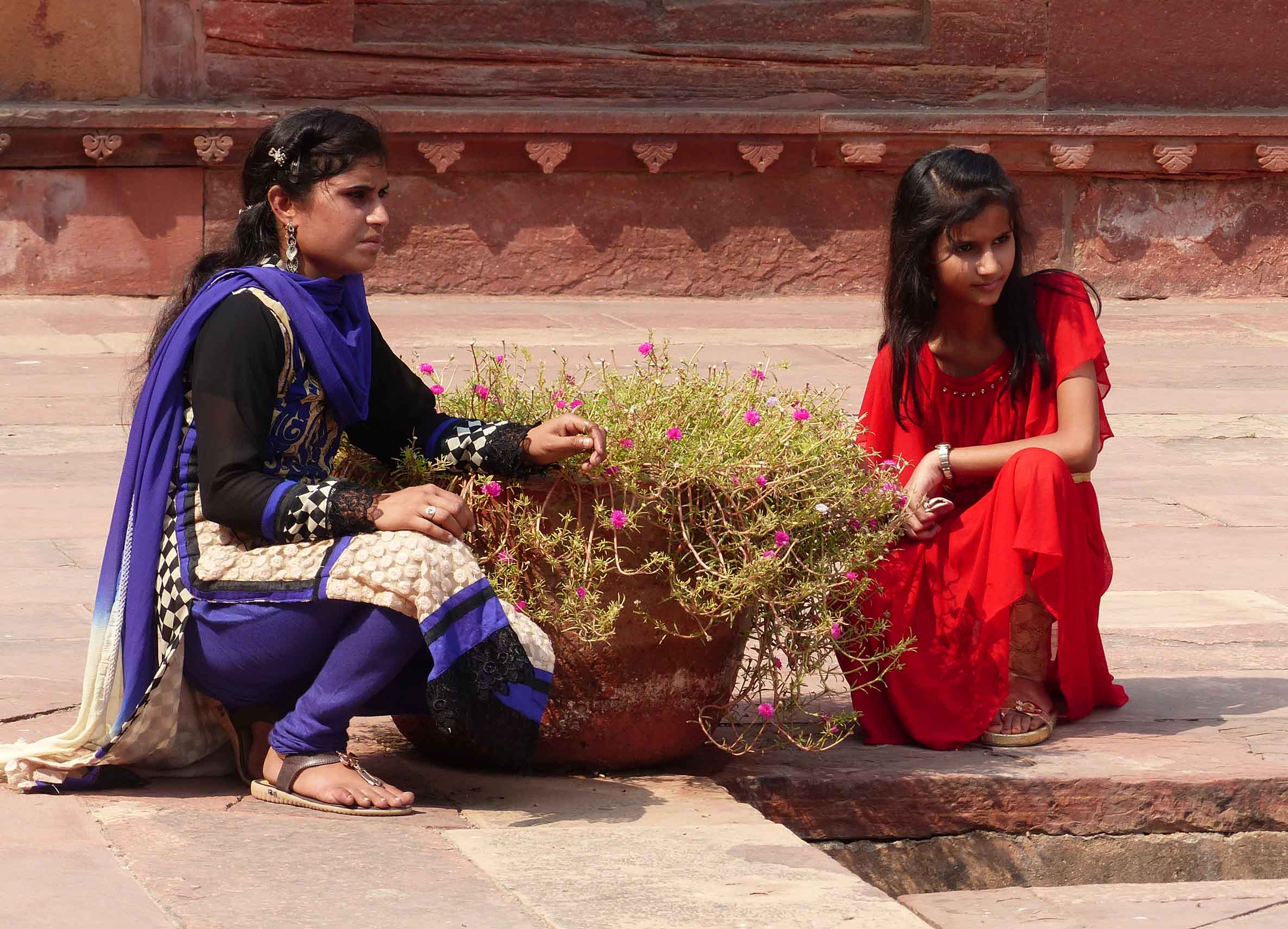 Two girls in bright saris