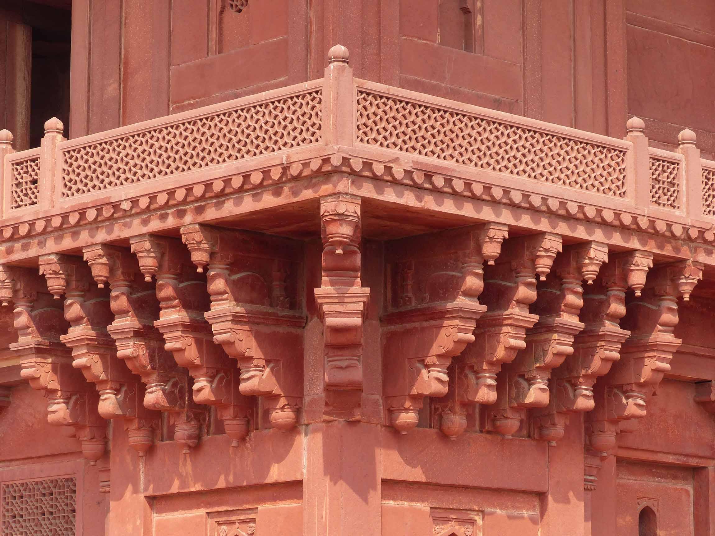 Carved red sandstone balcony