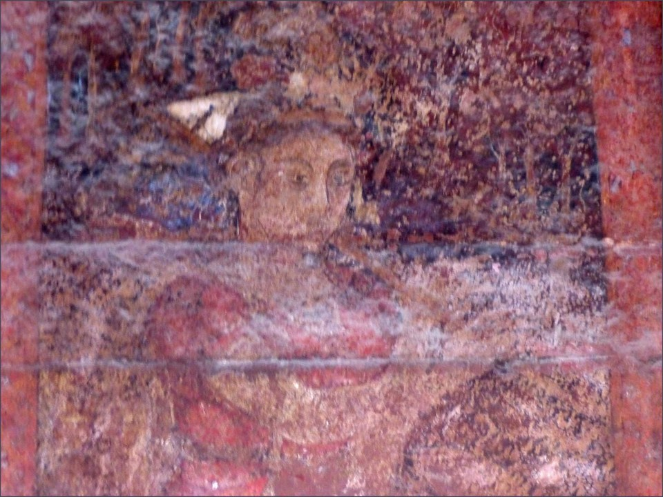 Faded wall painting of girl playing a flute