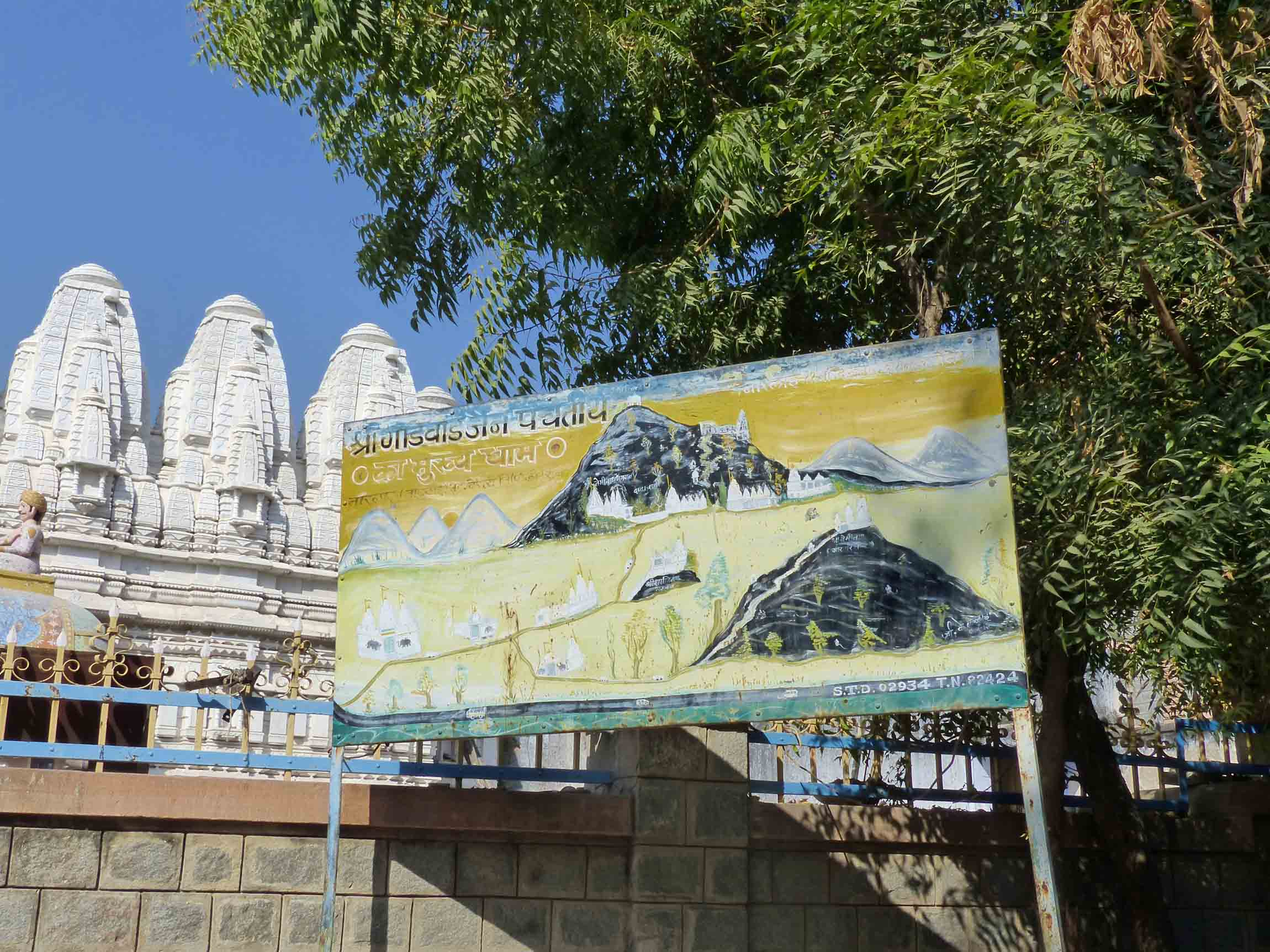 Large notice board in front of temple