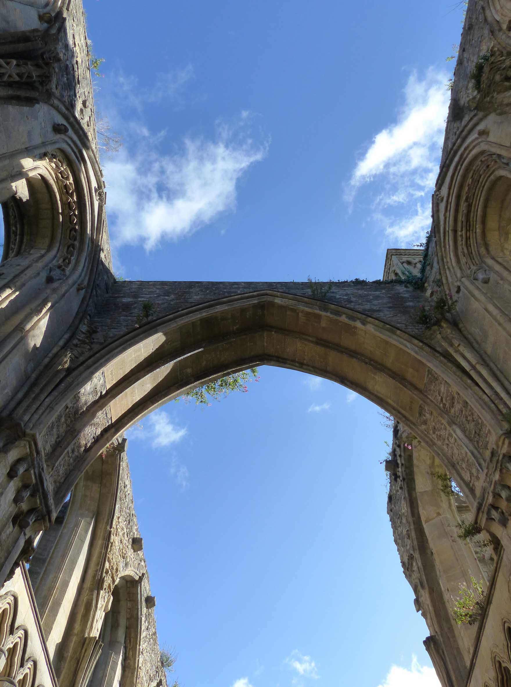 Looking up at the sky from inside ruins
