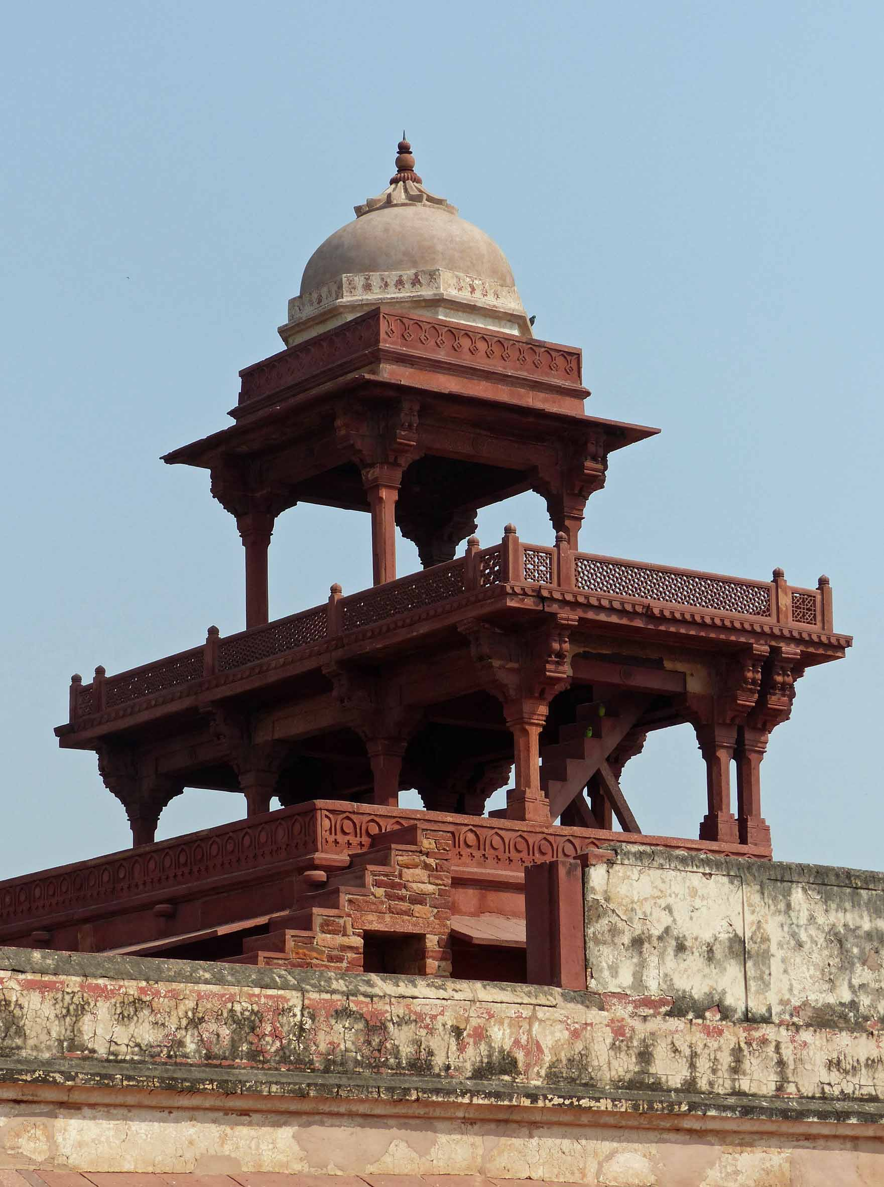 Ornate red sandstone roof and tower