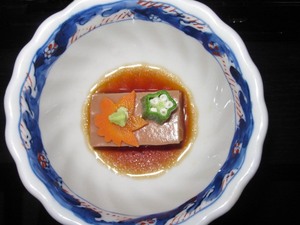 Decorated slice of tofu in a pretty bowl