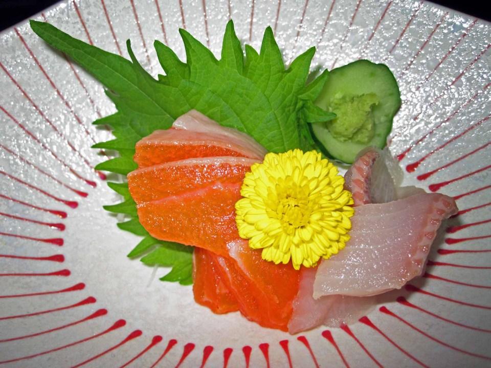 Sashimi with yellow flower as garnish
