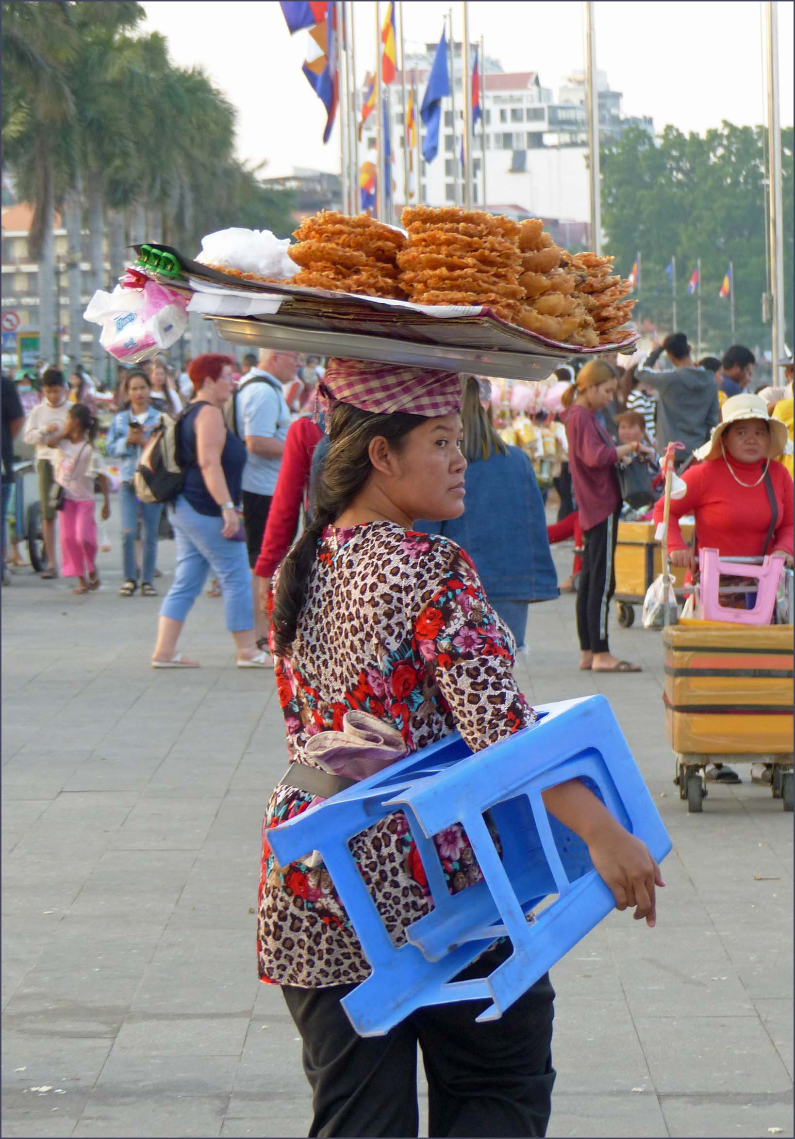 Woman with tray of food on her head