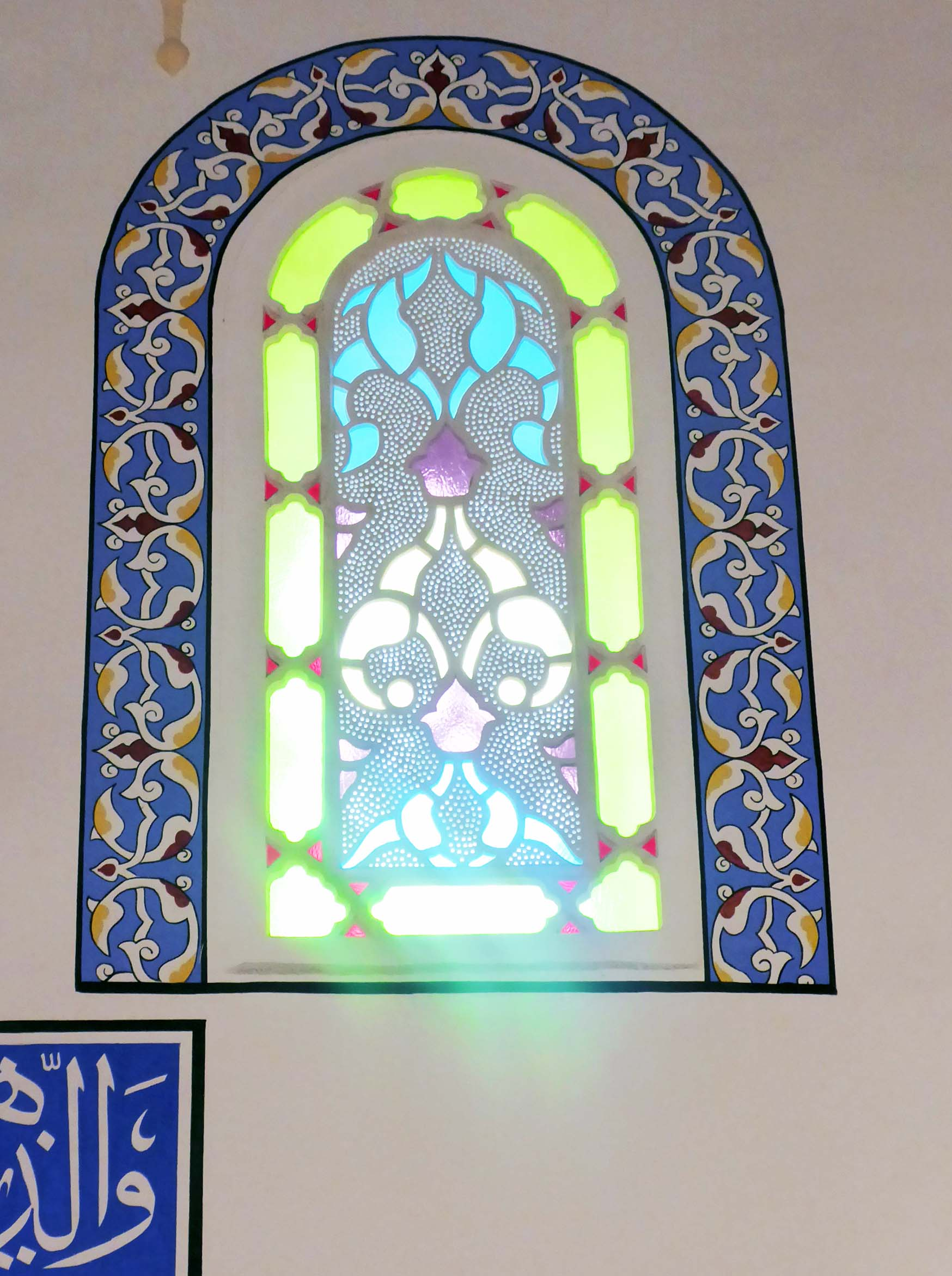 Stained glass window with blue painted frame