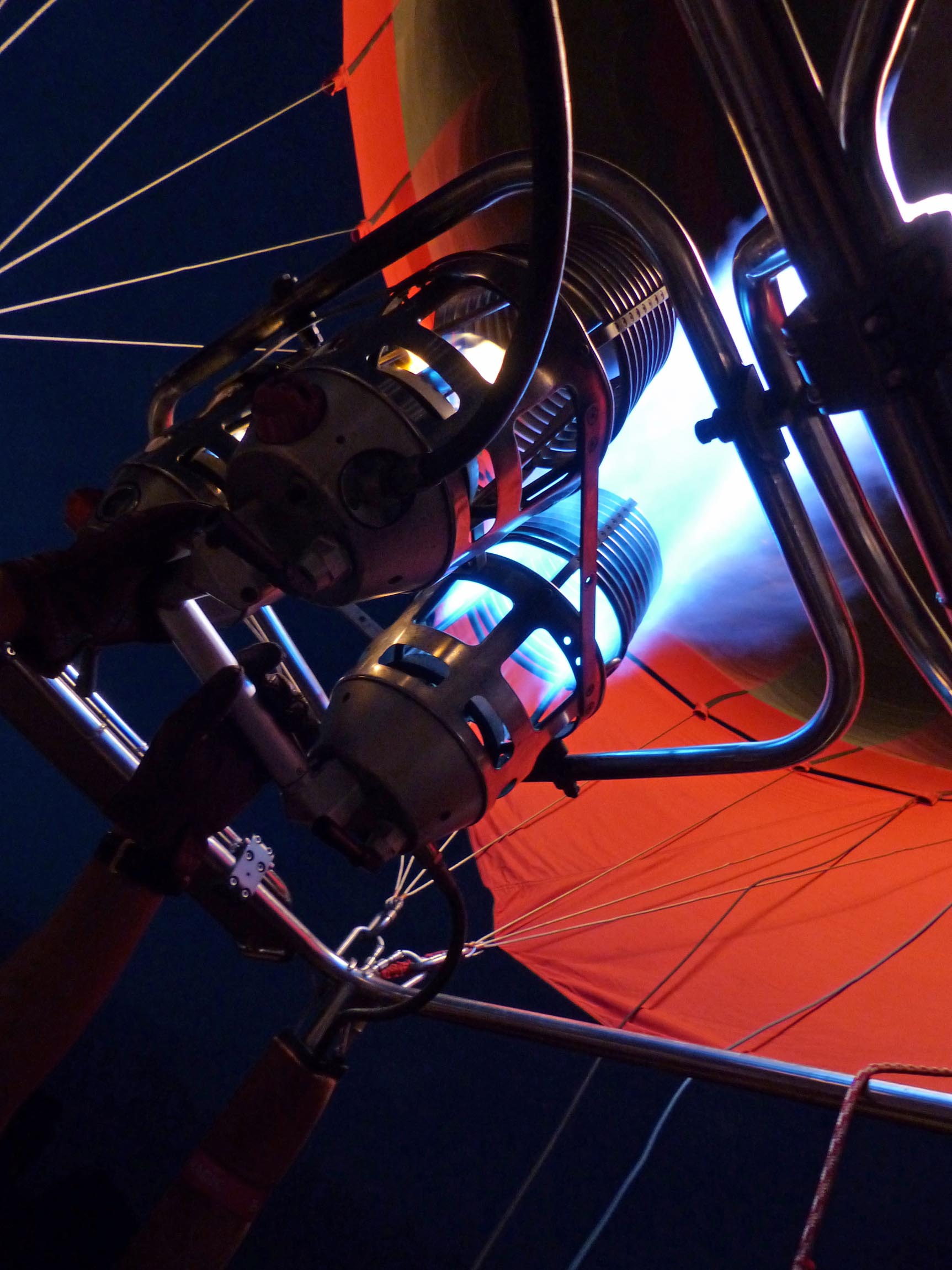 Looking up at the flame inflating a hot air balloon -