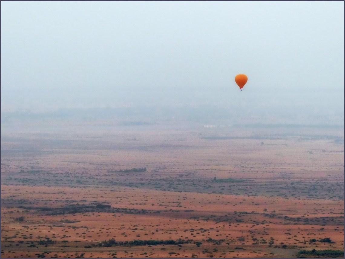Balloon over a desert landscape