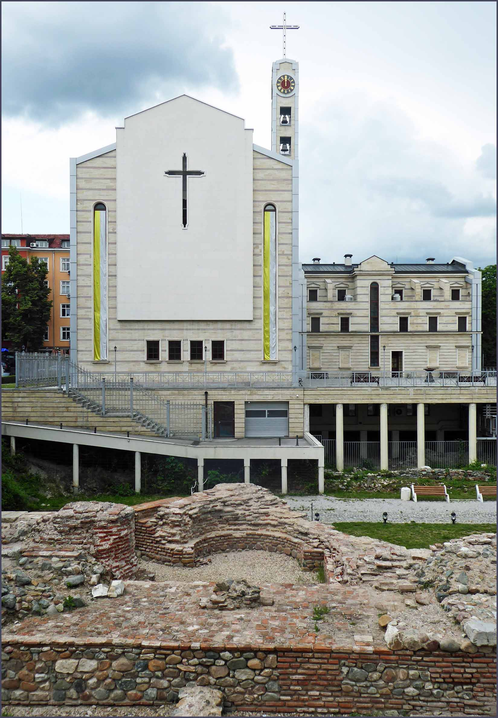 Modern cathedral with brick foundations in front
