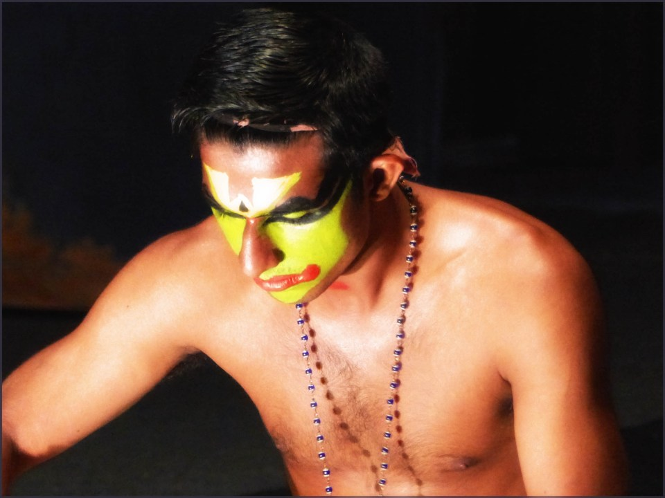 Man with colourful face paint