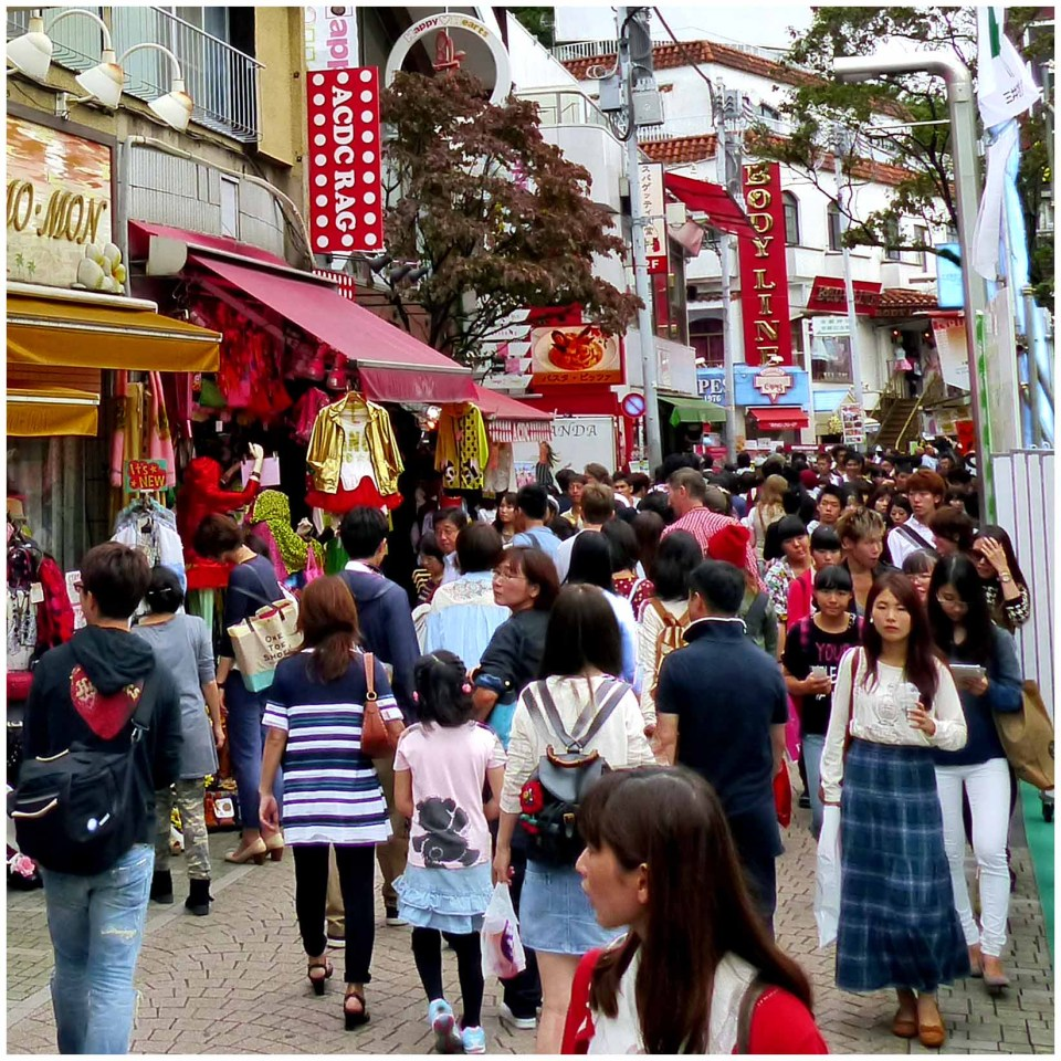 Lots of people on a narrow street
