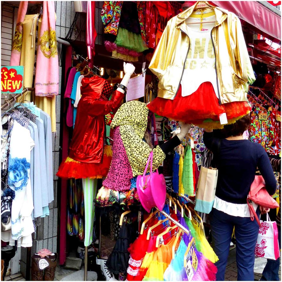 Colourful clothes hanging outside a shop
