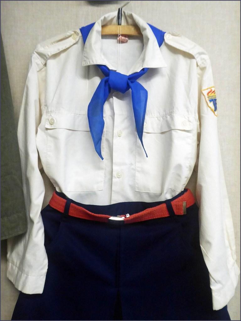 Girl's white shirt, dark skirt and blue tie