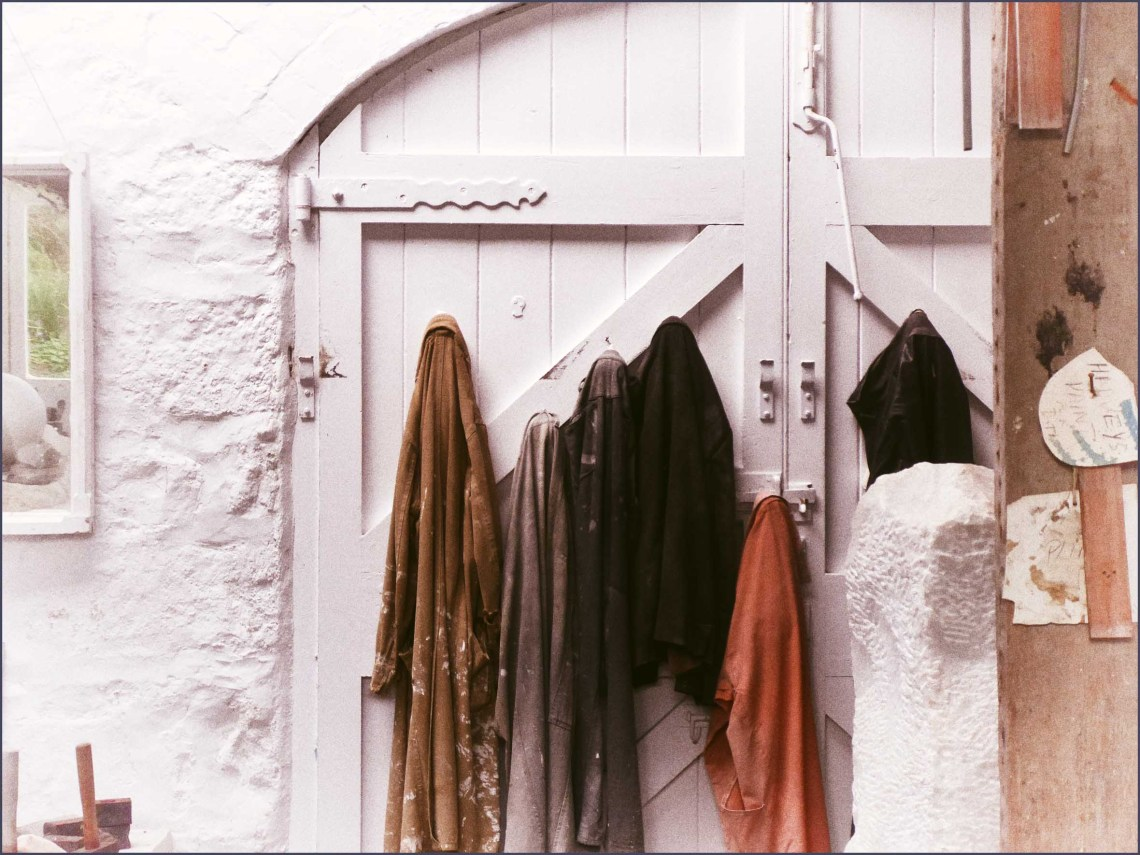 Clothes hanging on a white wooden door