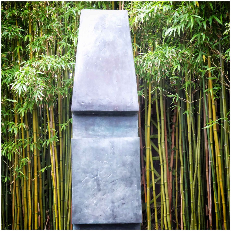 Modern sculpture in front of bamboo