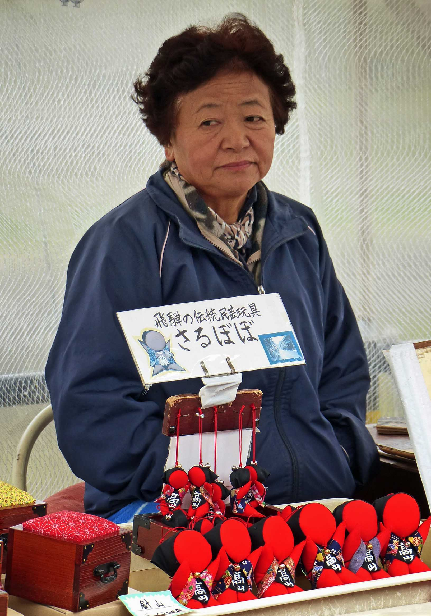 Lady selling small souvenirs