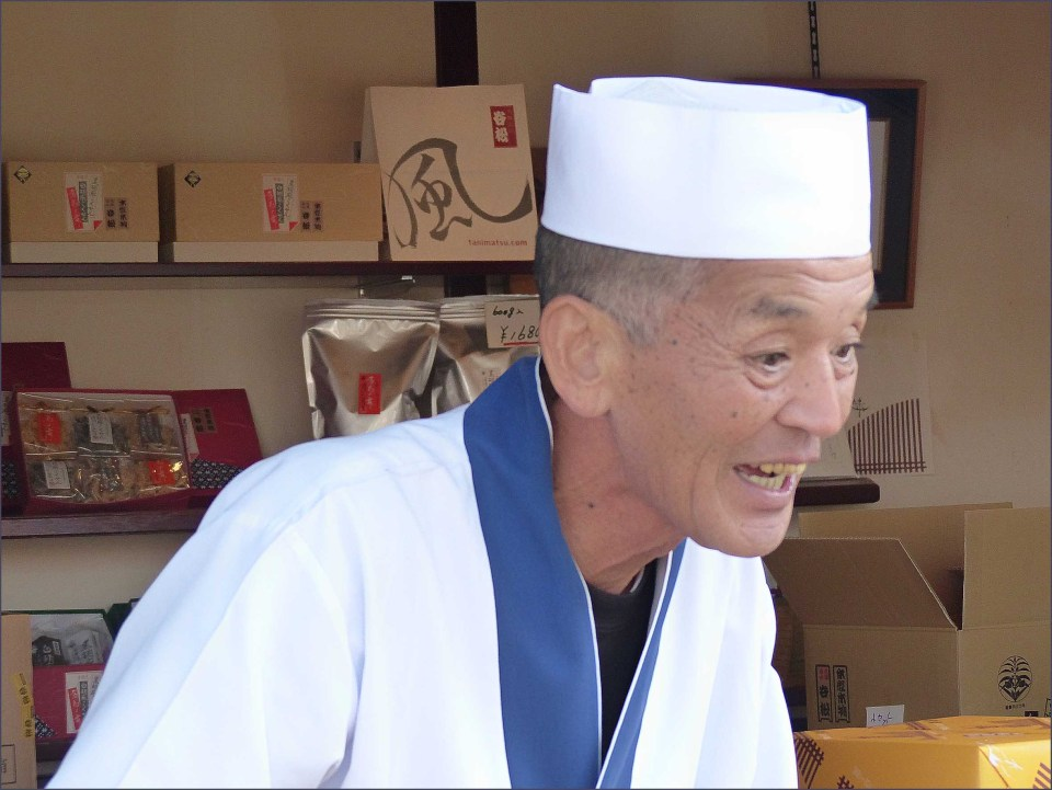 Smiling man in chef's whites