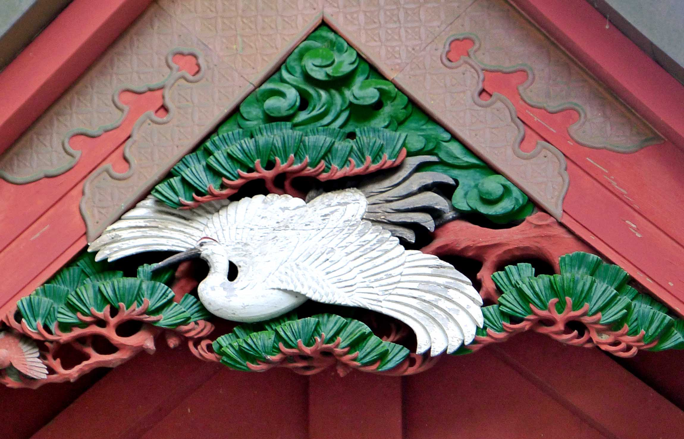 Carving of a white crane on a gable