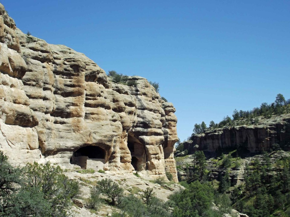Caves in a sandstone cliff with walls inside