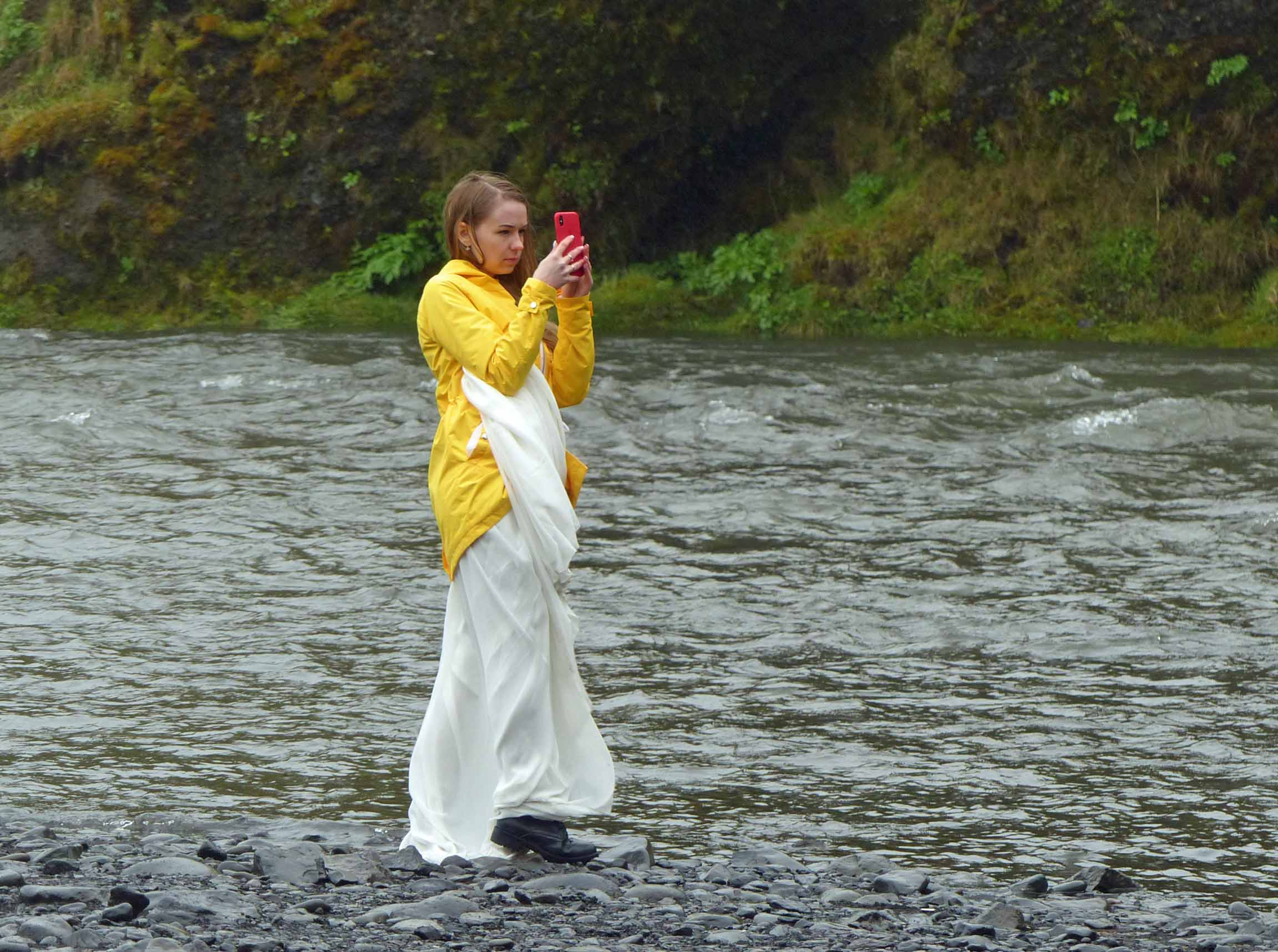 Girl in long white dress and yellow jacket