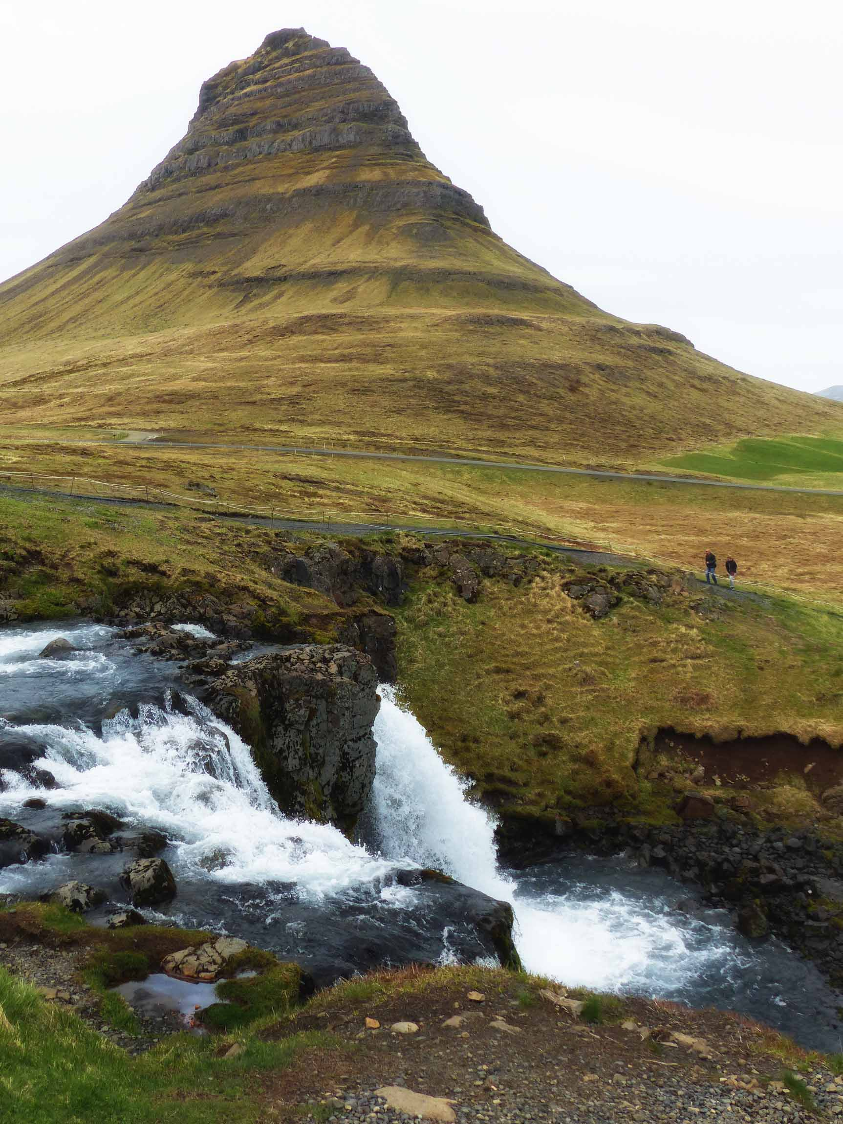 Waterfall in front of conical mountain