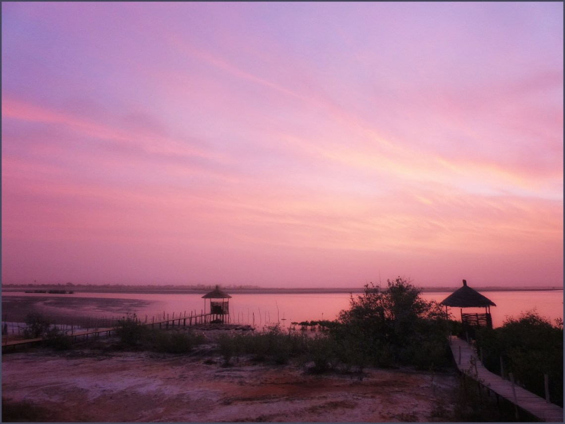 Pink sunrise over water