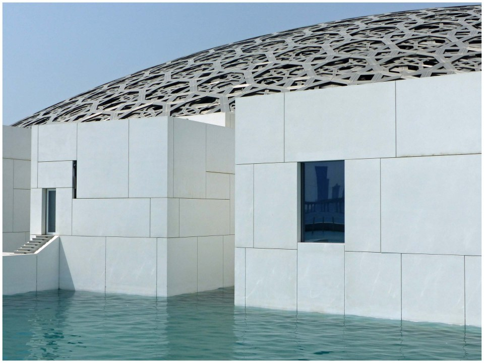 Modern white building with moat