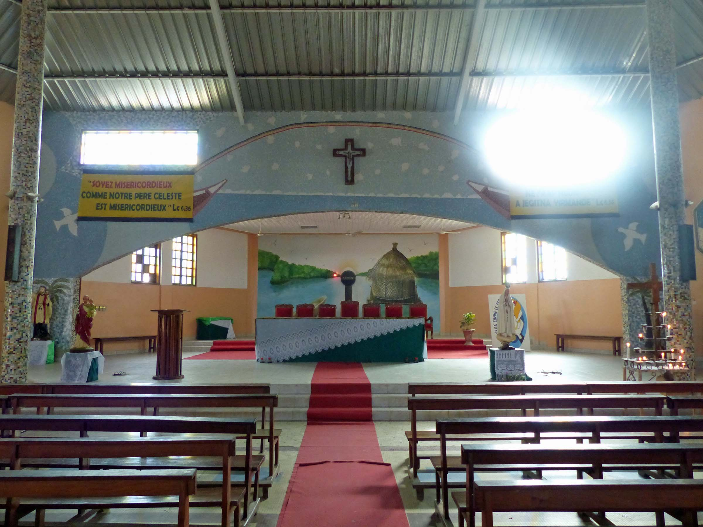 Simple church interior with tin roof