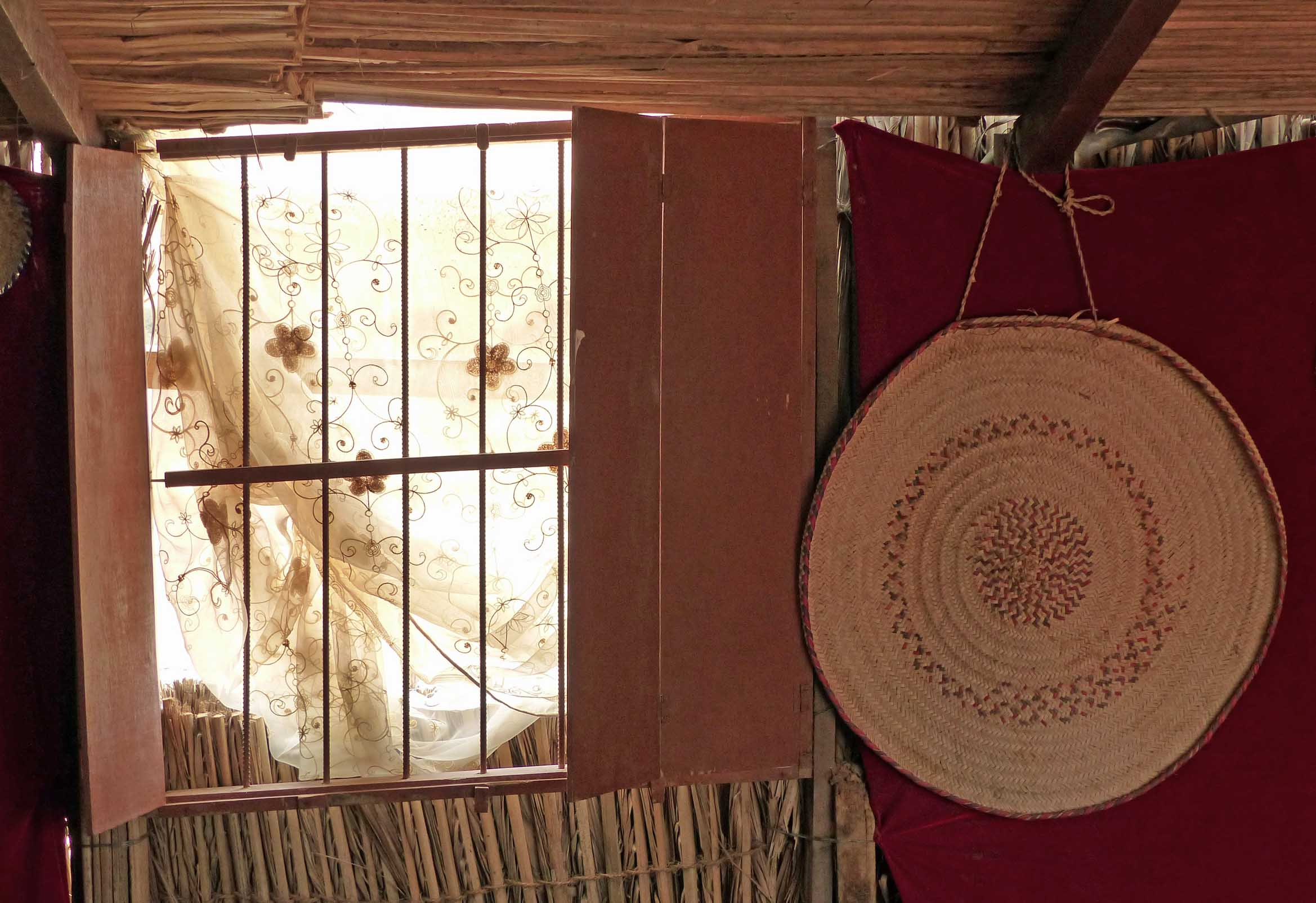 Window in stick wall with curtain