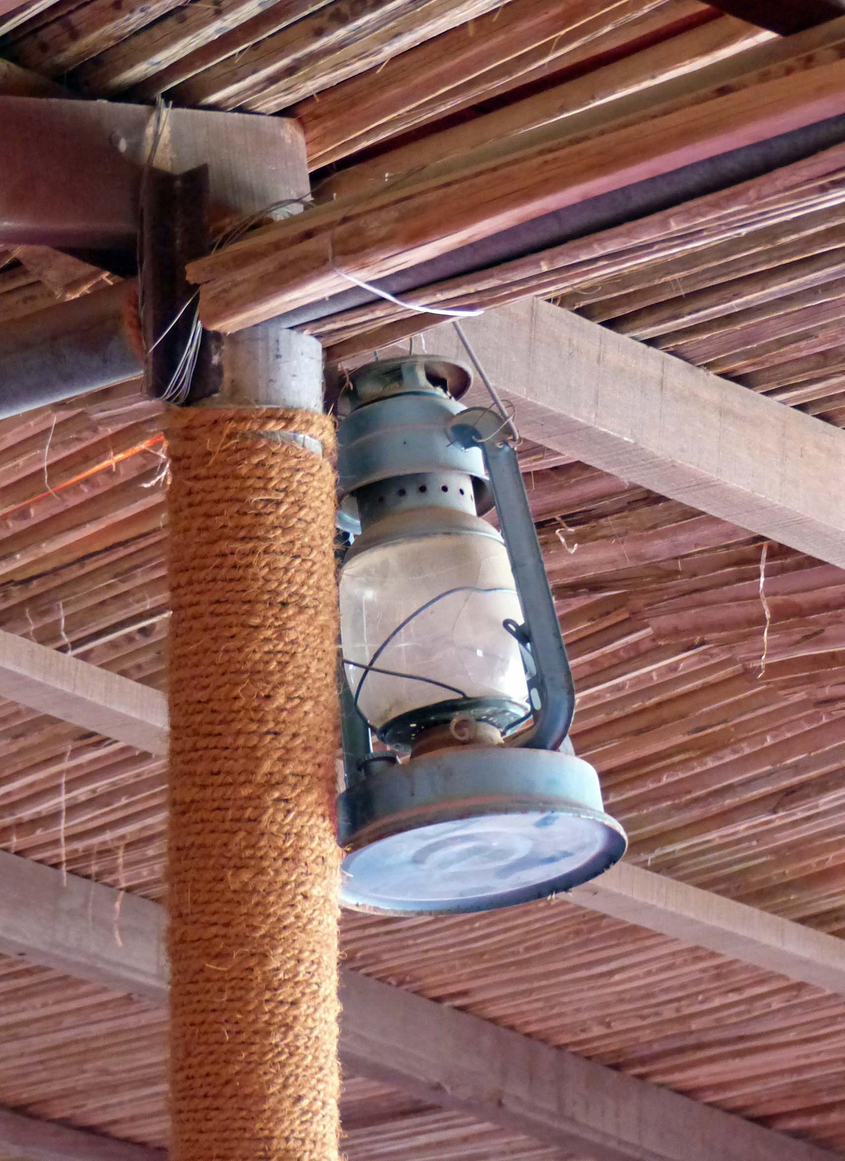 Oil lamp hanging from a stock ceiling