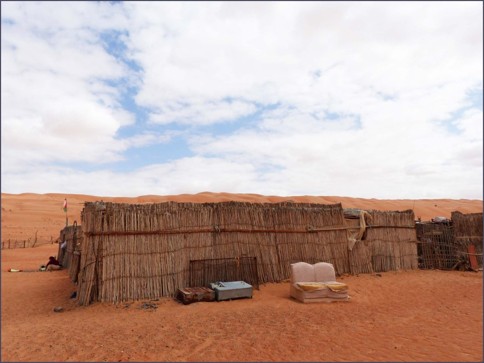 Rough fence on desert sand