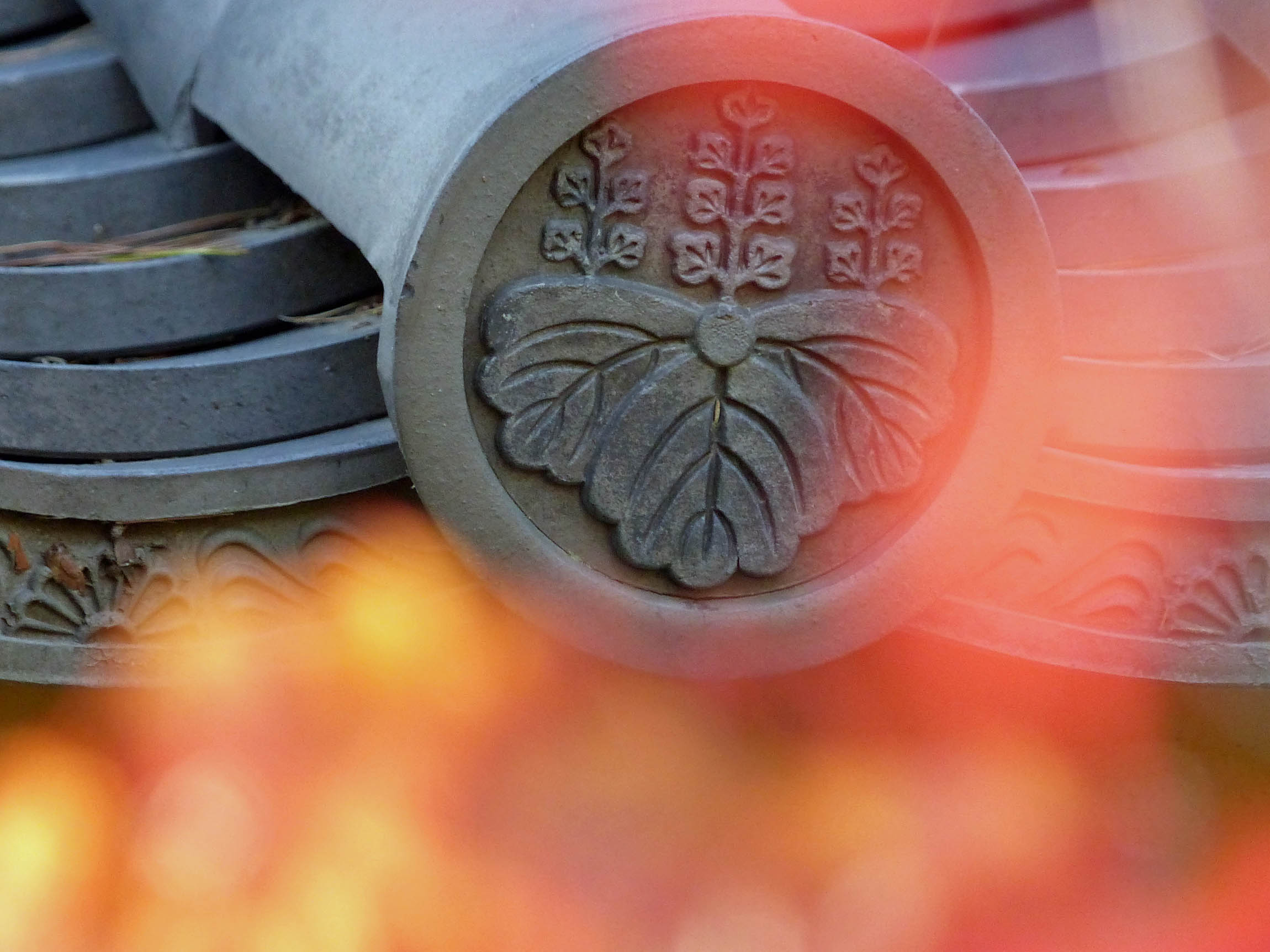Detail of Japanese roof tiles with autumn leaves