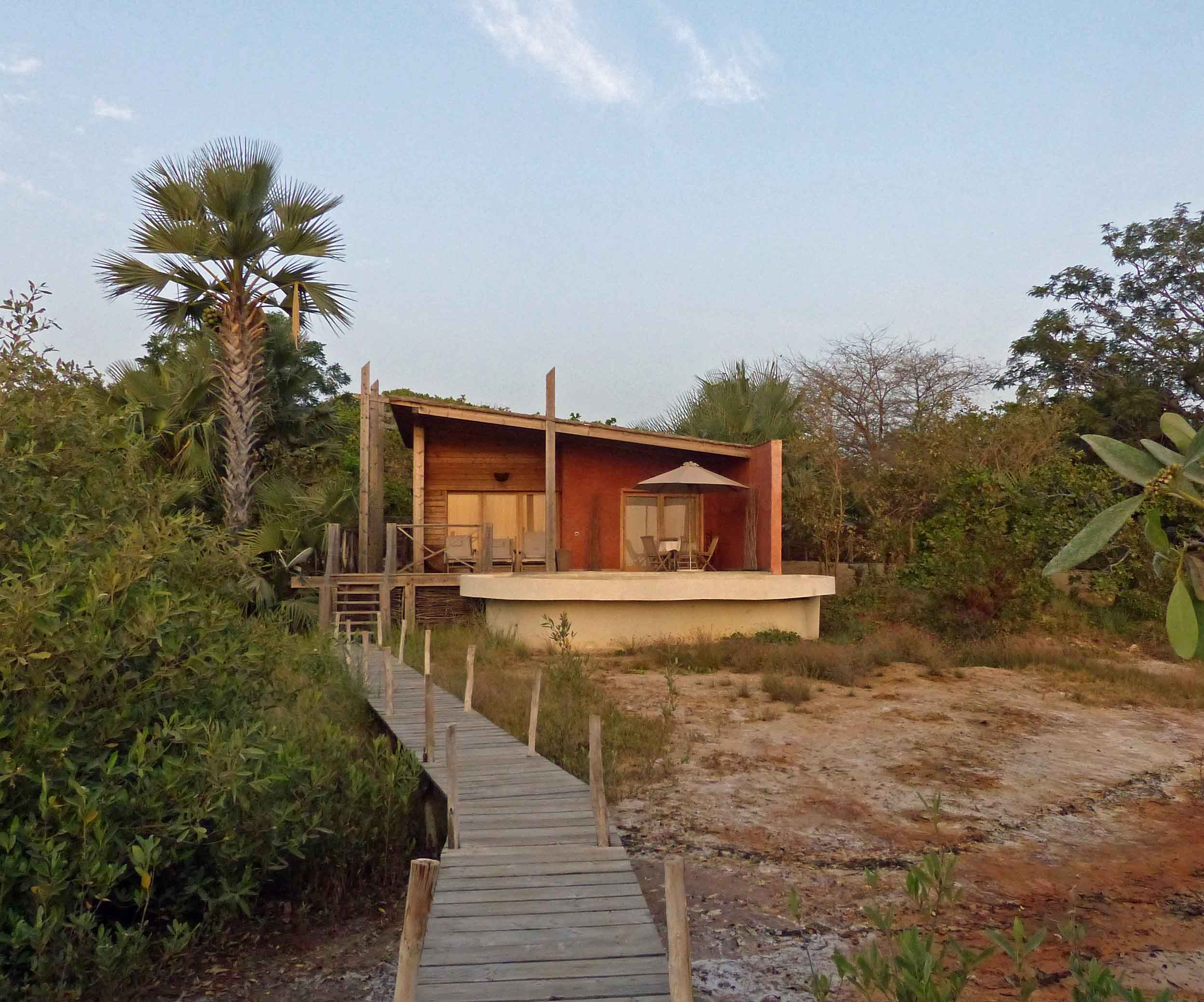 Boardwalk leading to a small bungalow