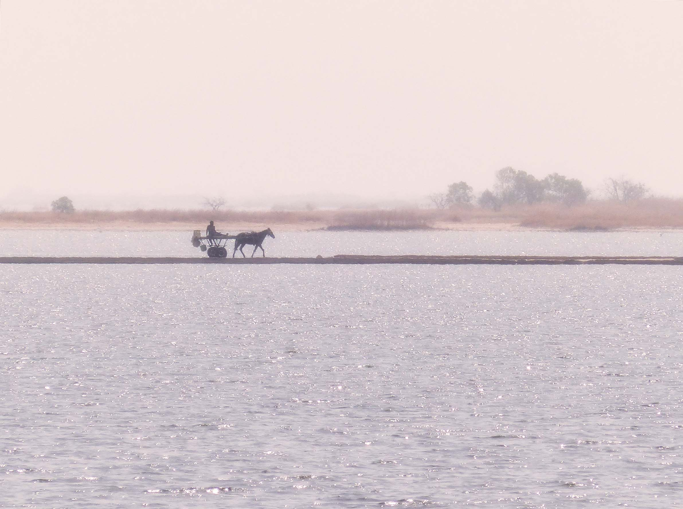 Horse and cart crossing a causeway