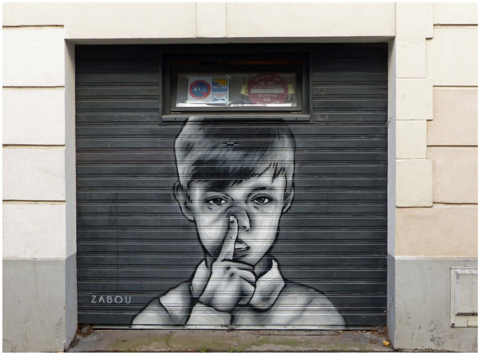 Painting of a boy on a garage door