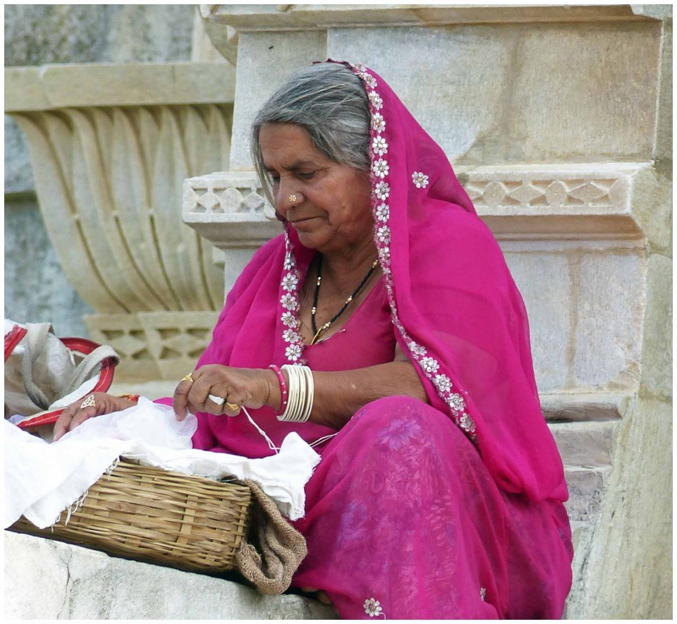 Lady in pink sari with basket