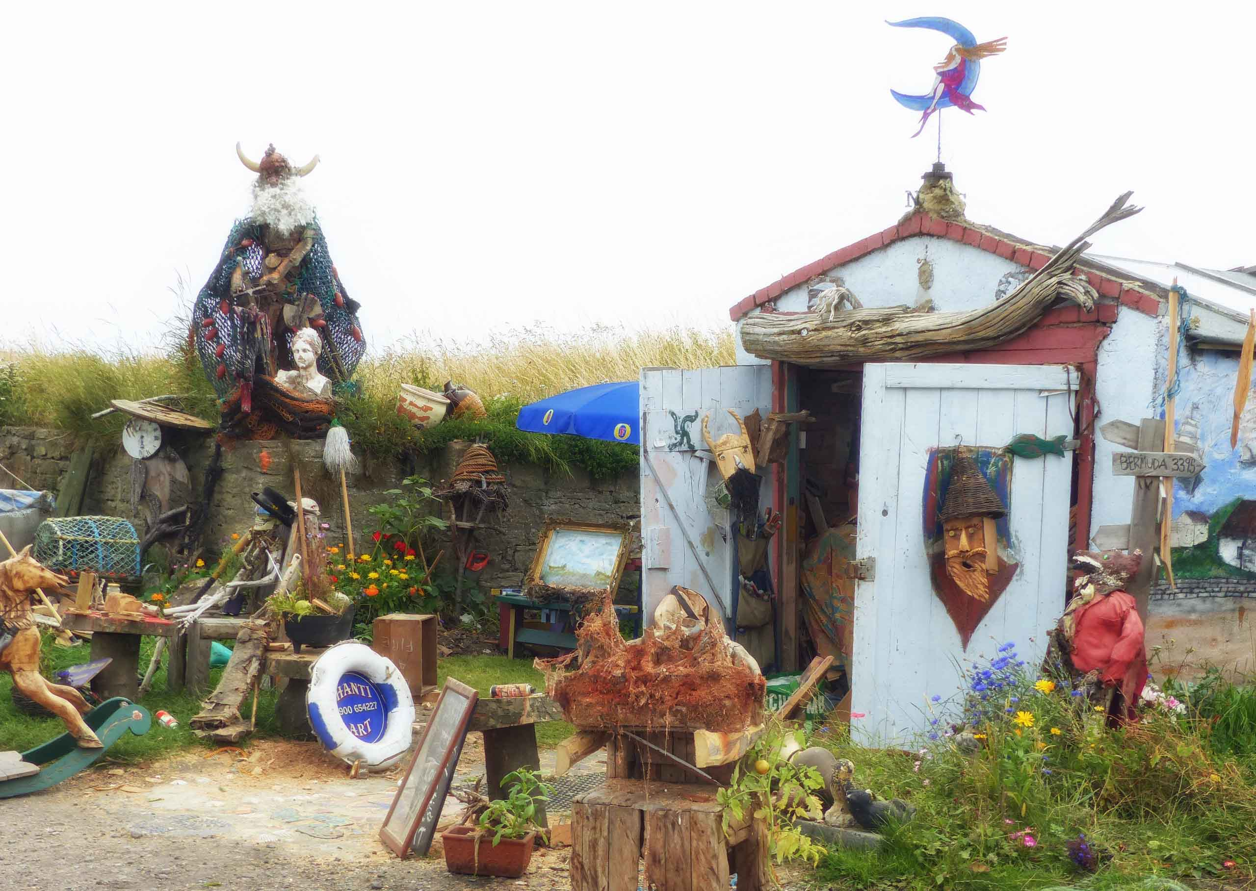 Wooden shed with bric-a-brac and carvings